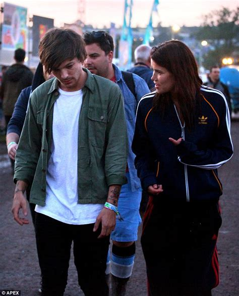 One Direction's Louis Tomlinson holding hands with Tamara