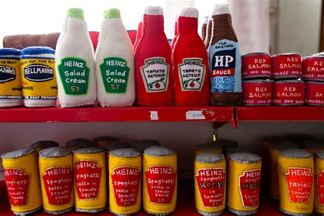 Artist Stocks the Shelves of a London Corner Store with