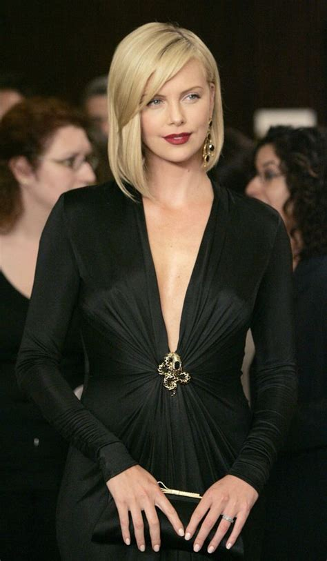 Great Ax: 18 Photos From Charlize Theron At Beach And